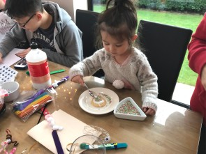 Lily-Jane decorates her biscuit