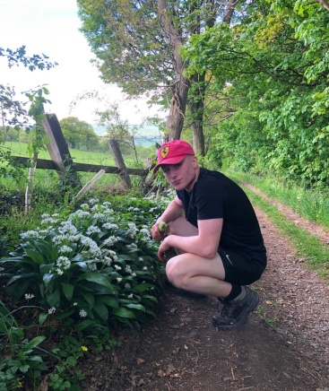 Max collects wild garlic roots